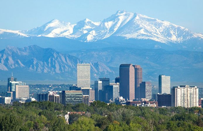 Denver Colorado skyline with mountains in background