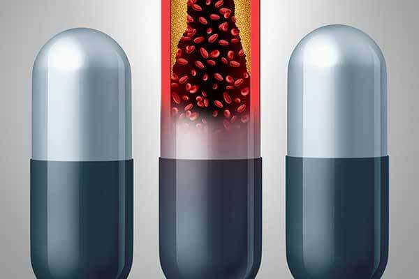 Illustration of capsule medications -- one has narrowed arteries