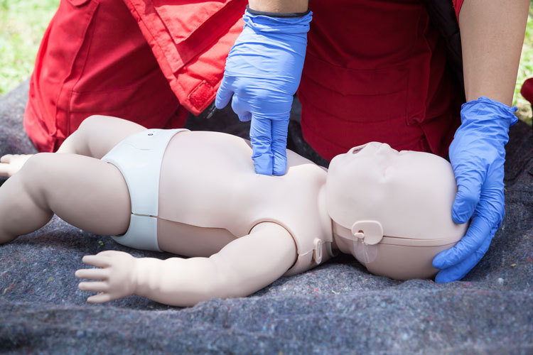 CPR training using an infant CPR dummy